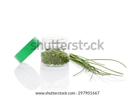Fresh chives and dry chive spice in glass jar isolated on white background. Culinary healthy aromatic herbs. Fines herbes, culinary arts. - stock photo
