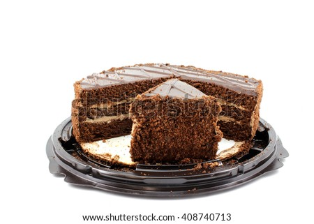 Fresh chocolate cake with cream and a piece cut - stock photo