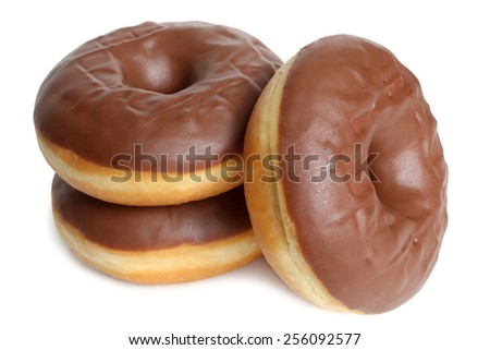 Fresh chocolate doughnuts on white background - stock photo