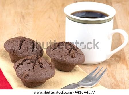 Fresh chocolate mini muffins - stock photo