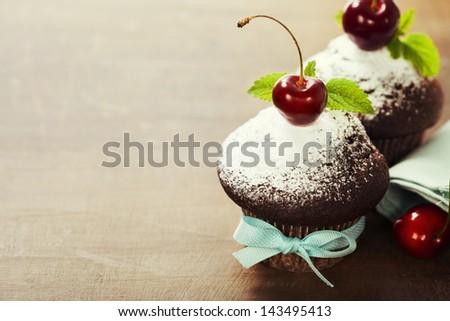 fresh chocolate muffins with cherry - stock photo