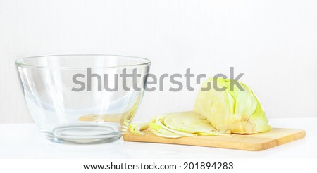 Fresh chopped cabbage on a cutting board closeup - stock photo