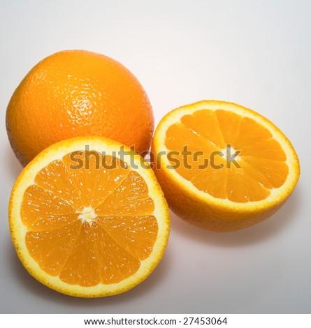 Fresh citrus oranges whole and sliced - stock photo