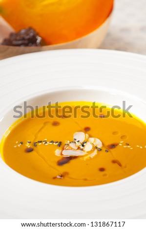 fresh classic traditional natural  pumpkin soup closeup macro - stock photo