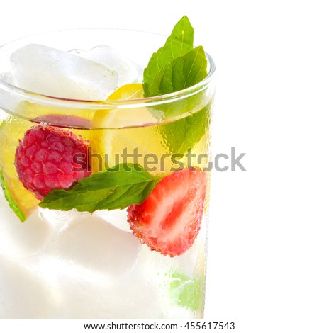 fresh cocktail drink with ice and fruits isolated on white - stock photo
