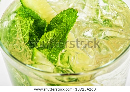Fresh cocktail with cucumber, apple juice, lemon juice and ice  isolated on white background - stock photo