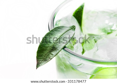 Fresh cocktail with lime slices isolated on white background - stock photo