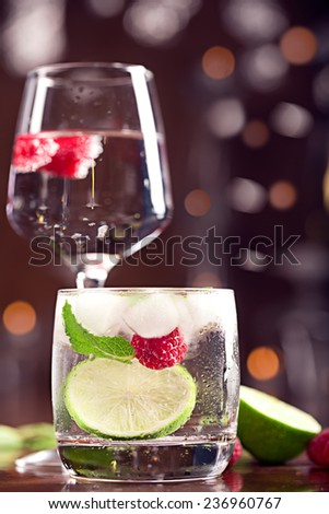 Fresh cocktails with mint and raspberry on the brown table - stock photo