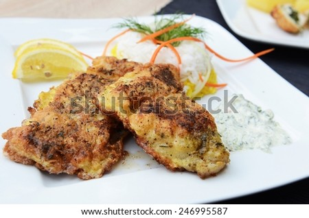 Fresh cod fillets in coating - stock photo