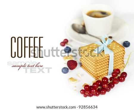 Fresh coffee and biscuits with berries on white background (with sample text) - stock photo