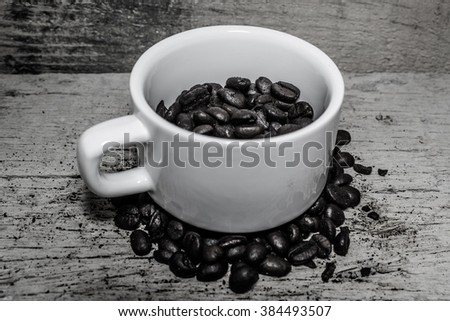 Fresh coffee beans In glass - stock photo