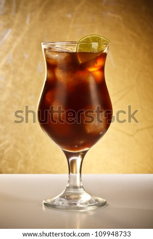 Fresh cola drink with ice and lime - stock photo