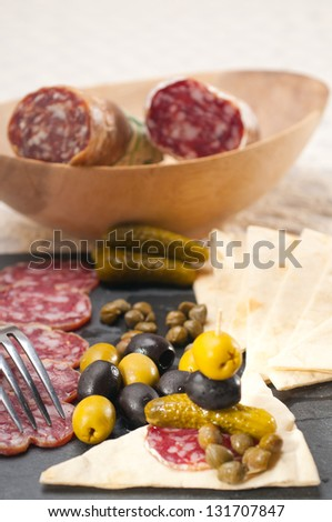 fresh cold cut platter with pita bread and pickles antipasti - stock photo