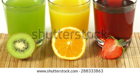 Fresh colorful fruit drinks with kiwi, orange and strawberry - stock photo