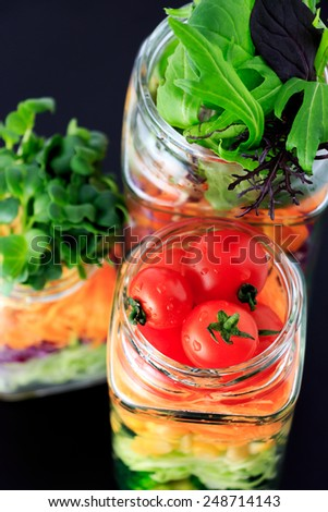 fresh colorful salad in the jar - stock photo