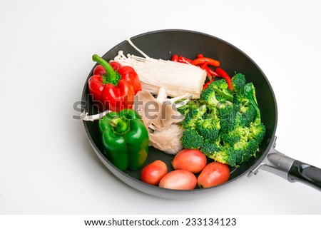 Fresh colour vegetables in pan isolated on white - stock photo