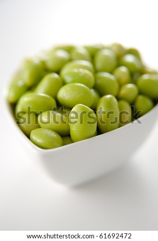 Fresh Cooked Edamame Soy Beans in White Bowl - stock photo