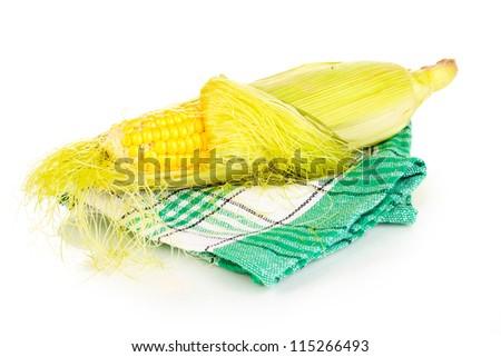Fresh corn cob on napkin isolated on white - stock photo