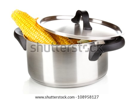 Fresh corn cobs in pot isolated on white - stock photo