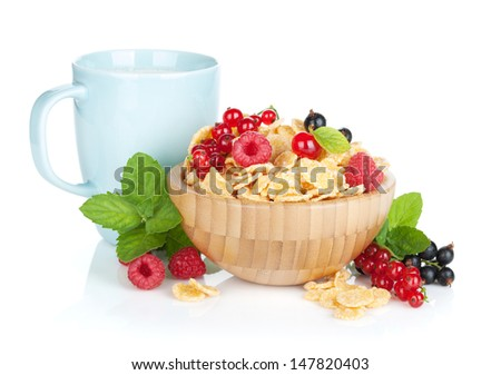 Fresh corn flakes with berries and milk cup. Isolated on white background - stock photo