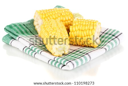 Fresh corn pieces on napkin isolated on white - stock photo
