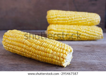 Fresh Corns on Wooden for Background Uses. - stock photo