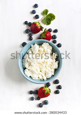 Fresh cottage cheese and berries for healthy eating - stock photo