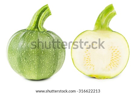 Fresh courgettes cut in half isolated on white background    - stock photo