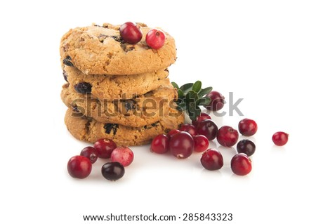 Fresh cowberries with cookies on white background - stock photo