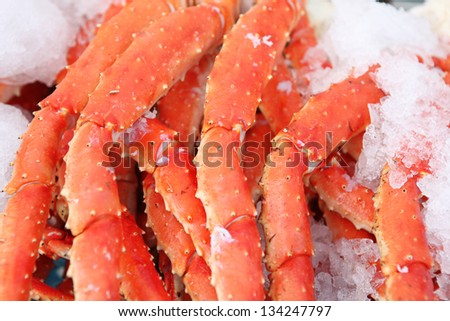 Fresh crab legs at a seafood market - stock photo