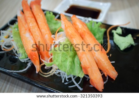 fresh crab stick with vegetables decorative on plate - stock photo