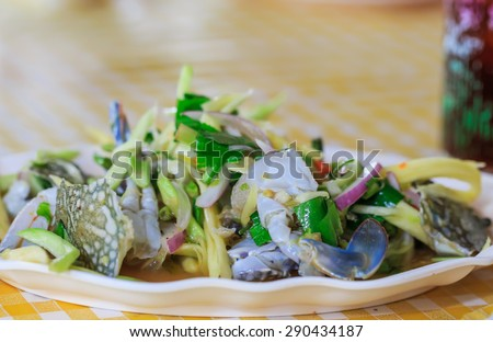 fresh crab with spicy salad in Thai style - stock photo