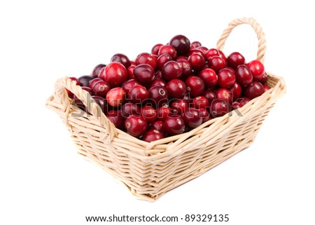 fresh cranberry in the wicker basket made in studio on white background - stock photo