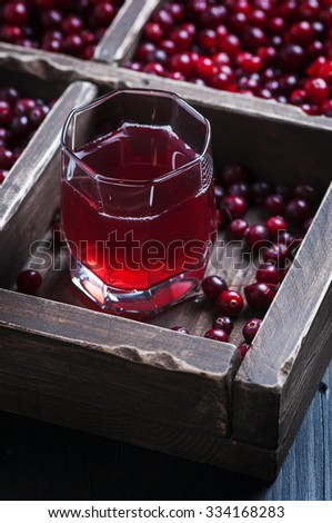 Fresh cranberry juice on the wooden table, selective focus - stock photo