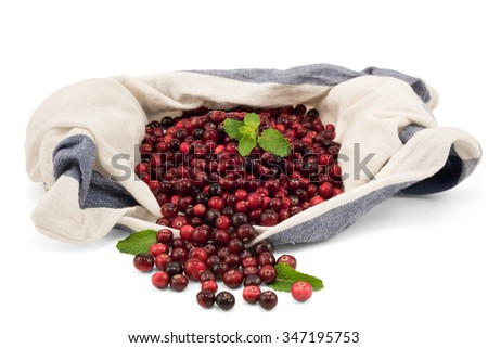 Fresh cranberry with mint in a linen towel isolated on white, selective focus, copy space. - stock photo