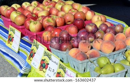 Fresh crisp apples for sale at a local outdoor food market in rural Michigan, USA. - stock photo