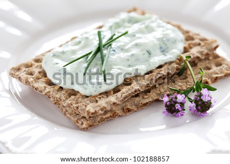 fresh crispbread with quark and chives - stock photo