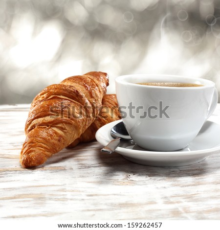 fresh croissant and coffee  - stock photo