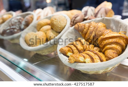 Fresh croissants in the shop - stock photo