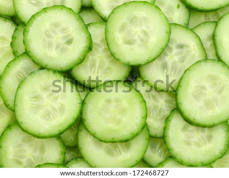 Fresh Cucumber and slices on background.  - stock photo