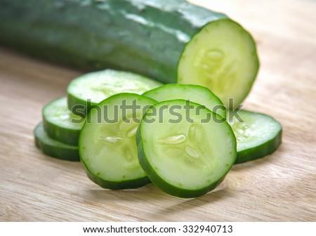 Fresh Cucumber  slices on wood background - stock photo