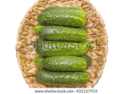 Fresh cucumbers in basket on wood,cucumbers in a basket,ripe vegetables,white background - stock photo