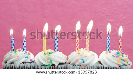 Fresh Cupcakes With Birthday Candles - stock photo