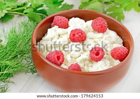 Fresh curd cheese with raspberries  - stock photo