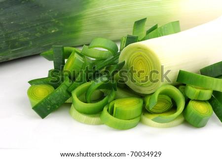fresh cut leek on a white background - stock photo