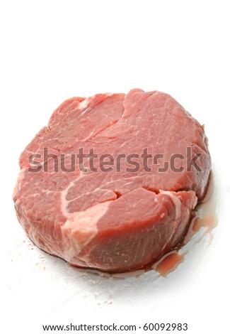 Fresh cut of beef tenderloin on steel plate - stock photo