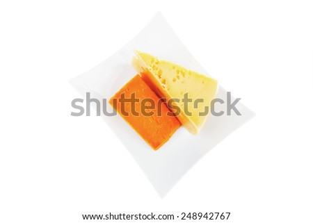 fresh dairy product : gourmet cheese triangles of yellow parmesan and orange cheddar on a plate isolated over white background - stock photo