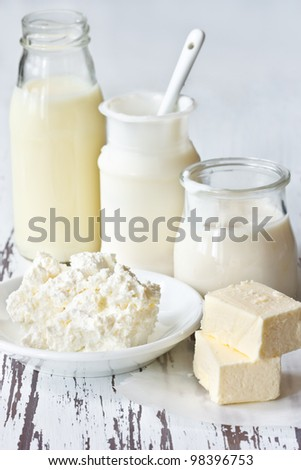 Fresh dairy products on an old kitchen board. - stock photo
