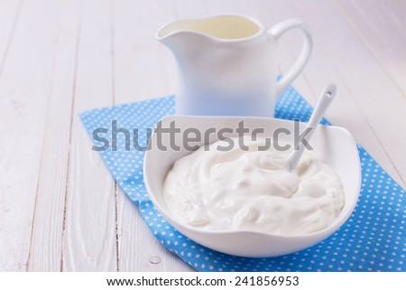 Fresh dairy products - sour cream,  milk.  Rustic style. Bio/organic/natural ingredients. Healthy eating.  - stock photo