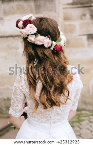 Fresh delicate magical wedding wreath  pink roses and red   peonies on beautiful  bride close-up. Wedding decoration - stock photo